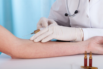 Hands giving vaccination injection