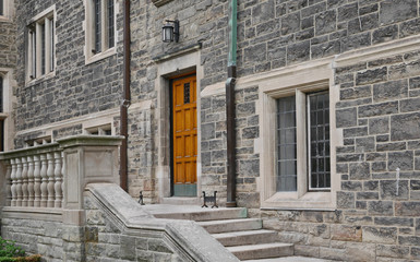 stone steps and balustrade of college building