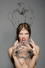 Screaming woman with a crown of barbed wire