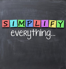Simplify things and everything concept text on blackboard with a