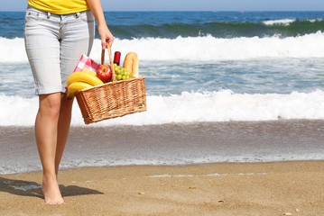 Picnic on the Beach. Female Legs and Basket