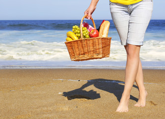 Picnic on the Beach. Female Legs and Basket with Food