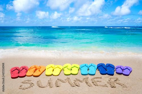 "Leinwanddruck Bild Sign ""Summer"" and color flip flops on sandy beach"