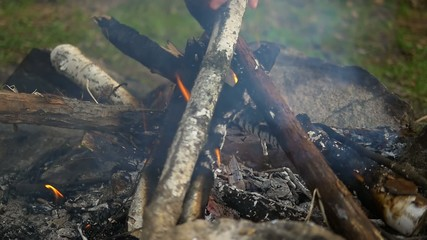 starting camping fire slow motion