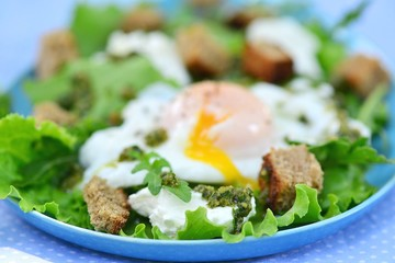 green salad with poached egg.