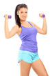 Attractive woman lifting dumbbells