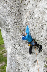 Female climber, woman climbing rock.