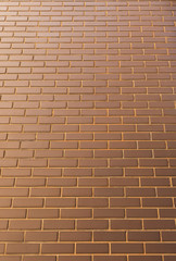 Modern brick wall in a bright sunny day as background. Look from