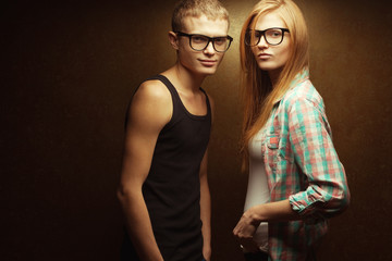 Eyewear concept. Smiling gorgeous red-haired twins