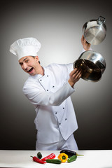 Humorous portrait of a chef beating pots