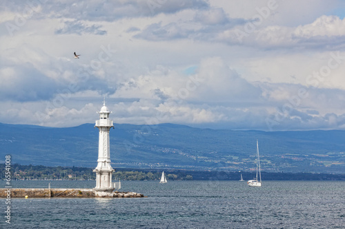 Beacon and sailing yacht on lake Leman in Geneva