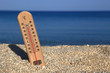 Thermometer on a beach shows high temperatures - 65541627