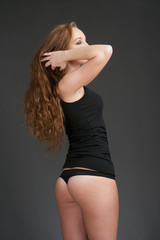 Young Woman with Long Brown Hair in Black Top and Panties