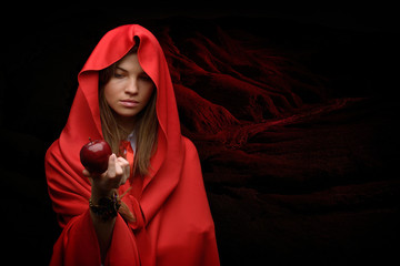 beautiful woman with red cloak and fruit