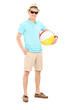 Young man holding a beach ball
