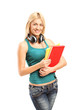 Blond girl with headphones holding notebooks