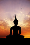 Buddha statue at sunset - 65544244