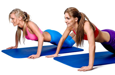 Young women doing push-up exercise