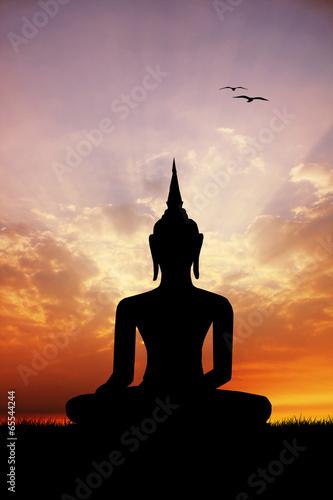 Zdjęcia na płótnie, fototapety, obrazy : Buddha statue at sunset