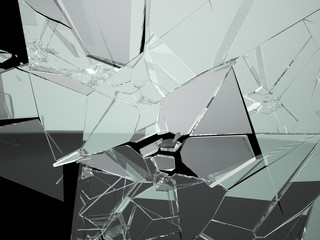 Many large pieces of shattered glass isolated on black