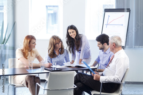 Business people discussing in a meeting poster