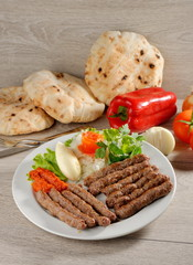 Cevapcici, a small skinless sausage cooked on the barbecue