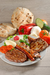 Mixed grill on a plate, Balkan food (selective focus)