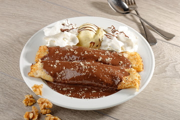 close up of two french style crepes, served with chocolate