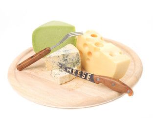Various types of cheeses on wood.