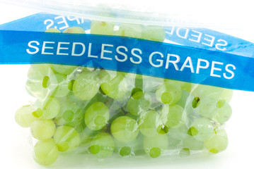 Seedless grapes in plastic bag isolated on white background.