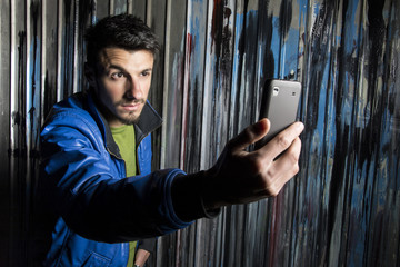 Fashion teenage boy using cellphone