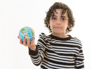 Child holding planet earth in his hands