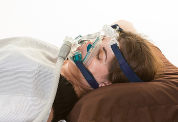 Woman suffering from sleep apnea