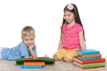 Two children with books on the floor