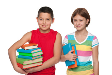 Preteen boy and girl with books