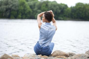 Sad woman sitting on rocks