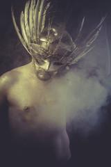 Nightmare, golden deity, man with wings and gold helmet