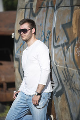 Urban fashion portrait wearing jeans and white shirt