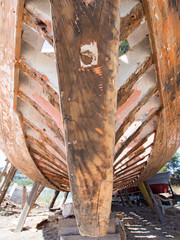 Front view of a fishing boat being restored