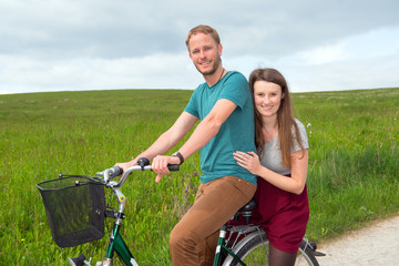 young man and woman on bicycle