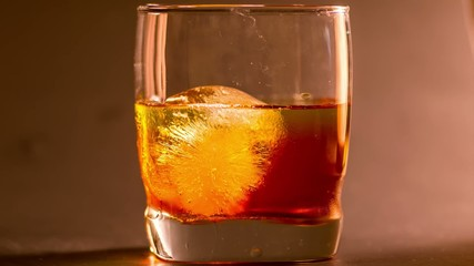 Whiskey on the rocks time lapse