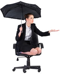 Businesswoman holding a black umbrella