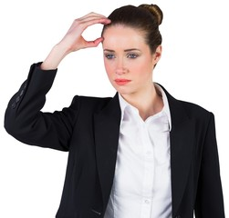 Businesswoman thinking and touching head