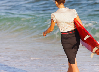 Businesswoman with surf near the ocean