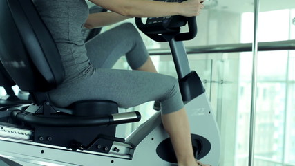 Woman riding stationary bike in the gym