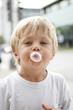 Child blowing a bubble gum