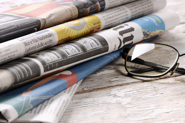 Glasses with the newspaper