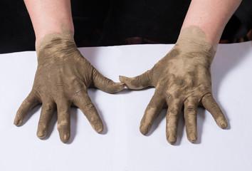 Woman applying spa cosmetic clay cream