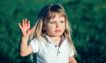 little girl waving