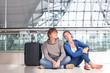 young couple waiting at airport terminal